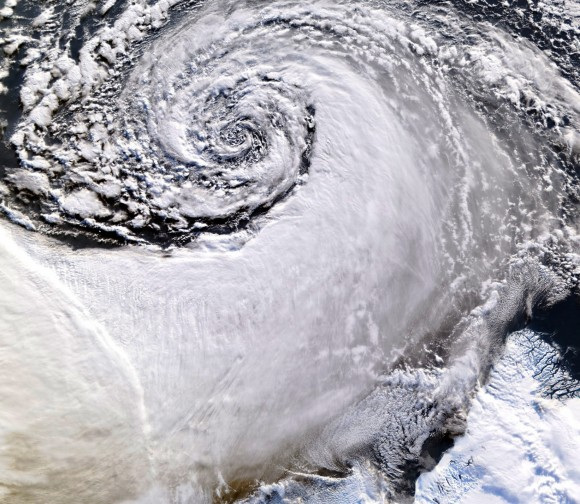 Satellite image of a cloud vortex off the coast of Greenland (NASA/MODIS/Chelys)