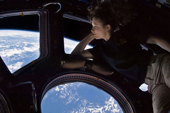 Expedition 24's Tracy Caldwell Dyson gazes out of the cupola. Credit: NASA
