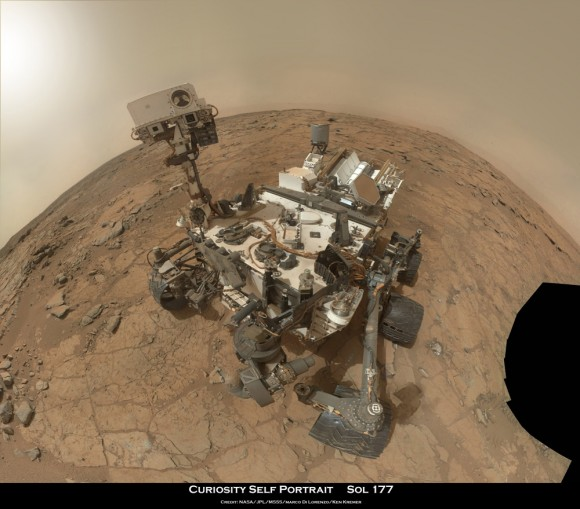 "Curiosity Rover snapped this new self portrait mosaic this week with the MAHLI camera while sitting on flat sedimentary rocks at the ""John Klein"" outcrop where the robot just conducted historic first sample drilling inside the Yellowknife Bay basin, on Feb. 8 (Sol 182) at lower left in front of rover. The photo mosaic was stitched from raw images snapped on Sol 177, or Feb 3, 2013, by the robotic arm camera - accounting for foreground camera distortion. Credit: NASA/JPL-Caltech/MSSS/Marco Di Lorenzo/Ken Kremer (kenkremer.com)"