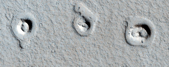 These unusual shapes on Mars surface are actually cones and inflated lava flows, Credit: NASA/JPL/University of Arizona.