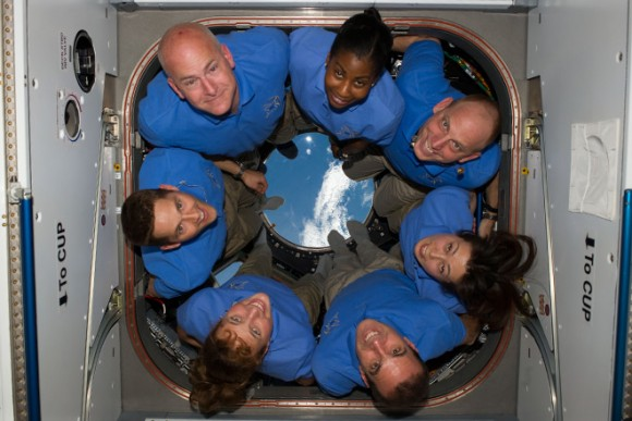 The STS-131 crew somehow organizes themselves on the small window in microgravity. Pictured are Commander Alan Poindexter, Pilot James P. Dutton Jr. and Mission Specialists Dorothy Metcalf-Lindenburger, Rick Mastracchio, Naoko Yamazaki, Clayton Anderson and Stephanie Wilson. Credit: NASA