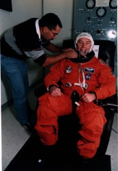 Jerry Ross suits up for the STS-74 mission in 1995. Credit: NASA.