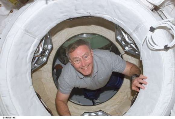 Jerry Ross during the  STS-110 mission in 2002, coming through one of the many hatches on the International Space Station. Credit: NASA.