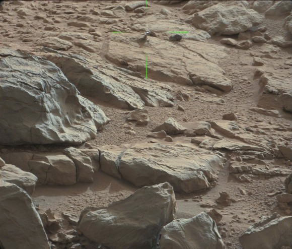 Green lines point to a shiny protuberance on rock imag
