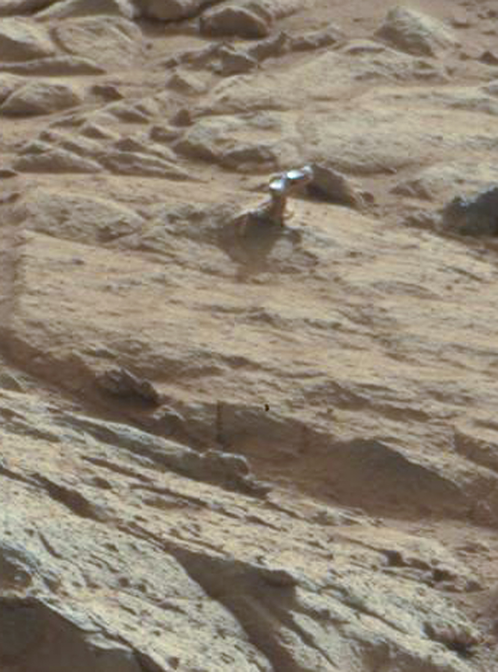 Scientist Explains the Weird Shiny Thing on Mars