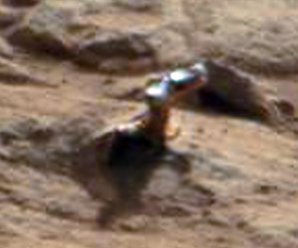 A closeup of the shiny protuberance. Credit: NASA/JPL/Malin Space Science Systems. Image editing by  2di7 &#038; titanio44 on Flickr.