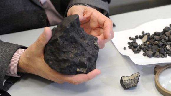 Lecturer at Ural Federal University's Institute of Physics and Technology Viktor Grokhovsky with meteorite fragment found during an expedition in the Chelyabinsk region on February 25, 2013. Credit: RIA Novosti / Pavel Lysizin.