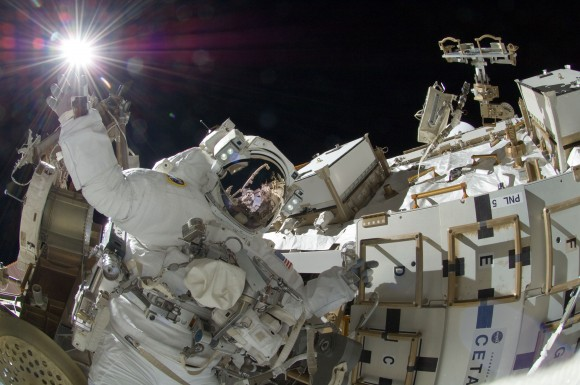 Sunita Williams appears to touch the sun during this spacewalk on Expedition 35 on the completed International Space Station. Credit: NASA