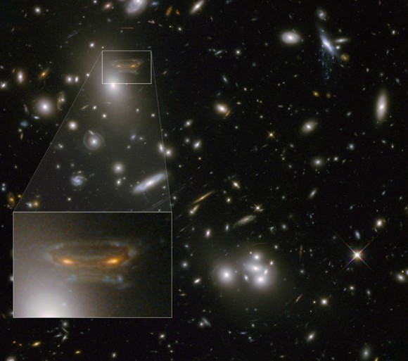 The image of a spiral galaxy has been stretched and mirrored by gravitational lensing into a shape similar to that of a simulated alien from the classic 1970s computer game Space Invaders Credit: NASA, ESA, and the Hubble Heritage/ESA-Hubble Collaboration