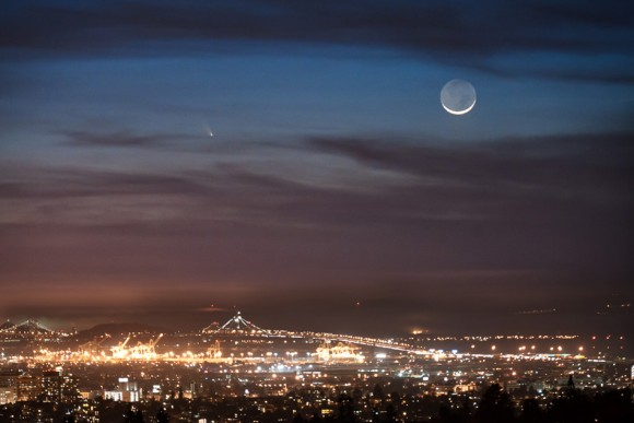 Comet PANSTARRS seen from Oakland, California.  The Port of Oakland and the Bay Bridge are in the foreground with the comet and crescent moon in the background. Taken on March 12, 2013. Credit and copyright: Jared Wilson.
