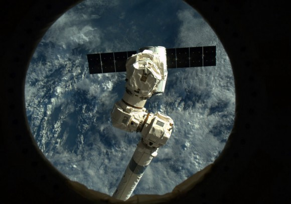 'Like a Praying Mantis, Canadarm2 poised to reach out and grab Dragon.' Credit: NASA/Chris Hadfield.