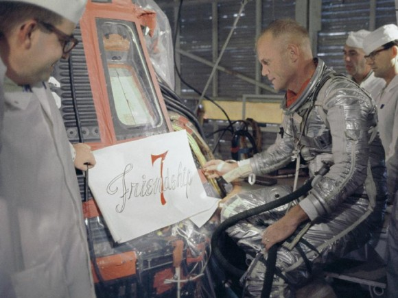 "Astronaut John Glenn views stencilling used as a model to paint the words ""Friendship 7"" on his spacecraft. Credit: NASA"