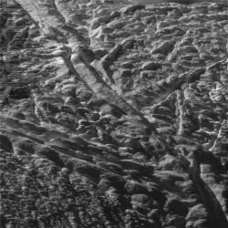 """Baghdad Sulcus,"" one of many tiger stripe fissures on Enceladus (NASA/JPL/SSI)"