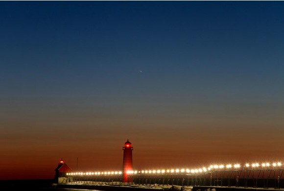 Comet C/2011 L4 (PANSTARRS) floats in the twilight sky over the lighthouses and pier at Grand Haven State Park in Grand Haven, Michigan on March 13, 2013. Credit and copyright: Kevin's Stuff on Flickr.