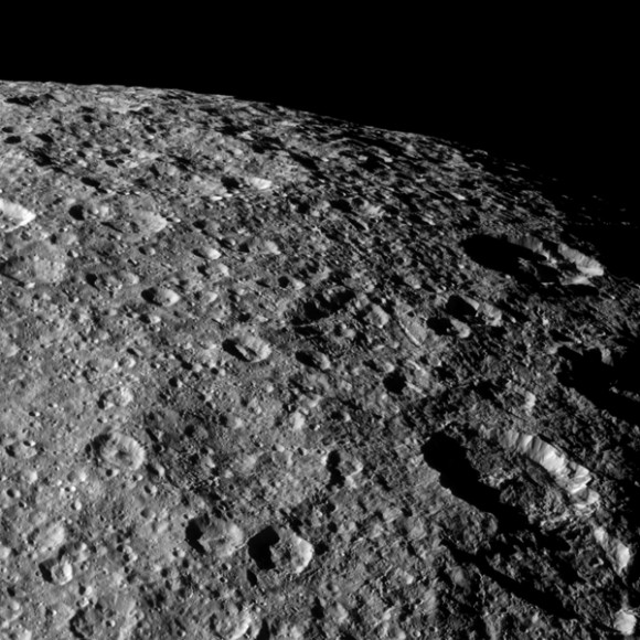 Cassini looks over the heavily cratered surface of Rhea during the spacecraft&#