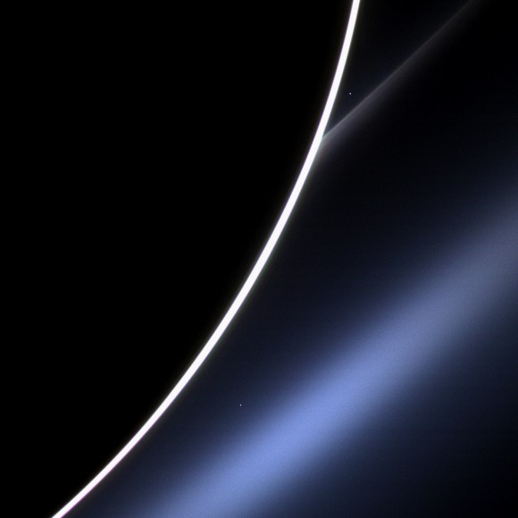 Venus appears just off the edge of the dark disc of Saturn, in the upper part of the image, directly above the white streak of Saturn's G ring. Credit: NASA/JPL-Caltech/Space Science Institute