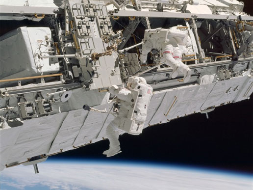 Astronauts perform an EVA outside of the ISS during STS-110. (Credt: NASA).