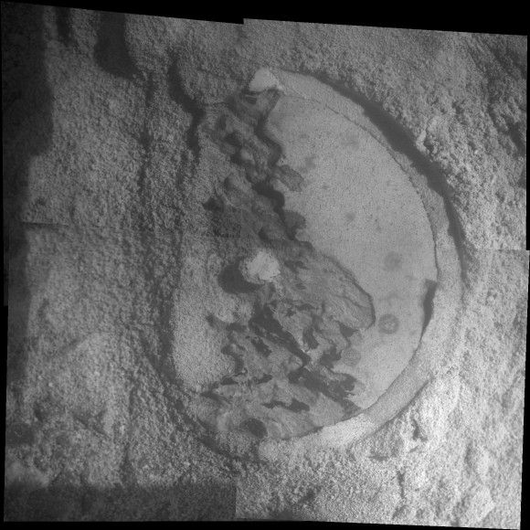"Close-Up of 'Esperance' After Abrasion by Opportunity This mosaic of four frames shot by the microscopic imager on the robotic arm of NASA's Mars Exploration Rover Opportunity shows a rock target called ""Esperance"" after some of the rock's surface had been removed by Opportunity's rock abrasion tool, or RAT. The component images were taken on Sol 3305 on Mars (May 11, 2013). The area shown is about 2.4 inches (6 centimeters) across. Credit: NASA/JPL-Caltech/Cornell/USGS"