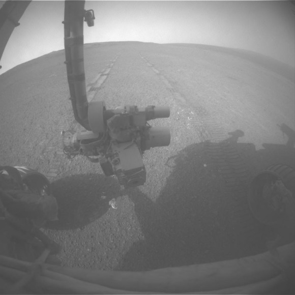 View Back at Record-Setting Drive by Opportunity. On the 3,309th Martian day, or sol, of its mission on Mars (May 15, 2013) NASA's Mars Exploration Rover Opportunity drove 263 feet (80 meters) southward along the western rim of Endeavour Crater. That drive put the total distance driven by Opportunity since the rover's January 2004 landing on Mars at 22.220 miles (35.760 kilometers. This exceeded the distance record by any NASA vehicle, previously held by the astronaut-driven Apollo 17 Lunar Rover in 1972. Credit: NASA/JPL-Caltech