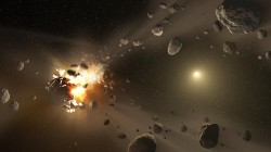 """An artist's conception of an asteroid collision, which leads to how """"families"""" of these space rocks are made"""