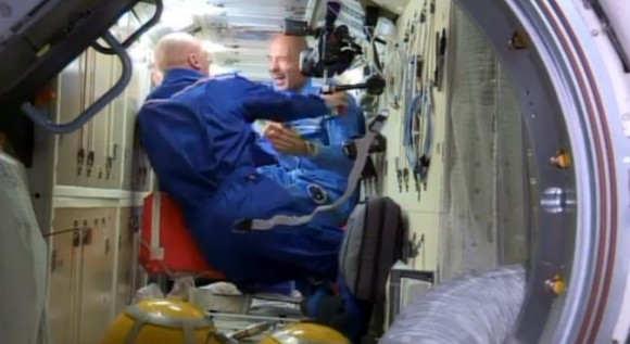 Italian astronaut Luca Parmitano, right, reacts to NASA astronaut Chris Cassidy's shaved head, a welcome present for the bald Parmitano