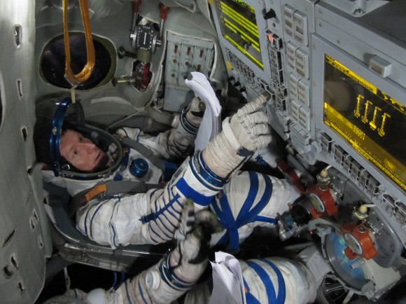 British astronaut Timothy Peake training in a Soyuz simulator. (European Space Agency)