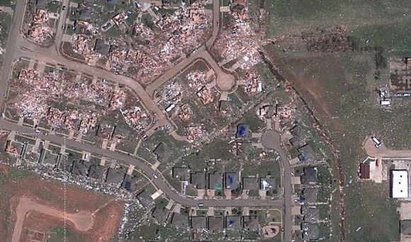 Sceenshot of a satellite view from Google/Digital Globe of the destruction in Moore, Oklahoma after the May 20, 2013 tornado. Click image to have access to an interactive, zoomable version via NPR.