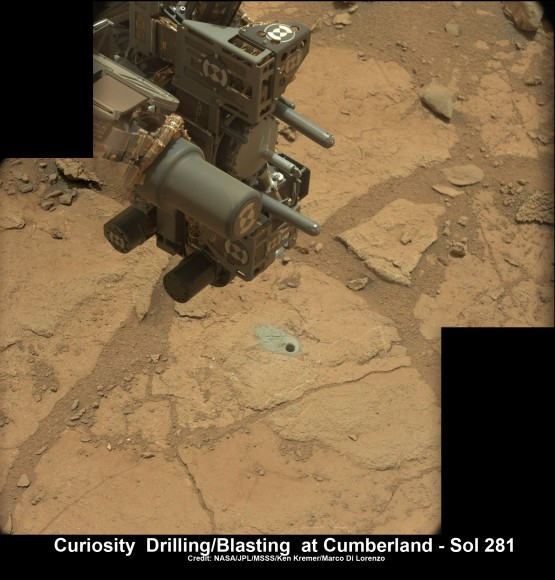 Curiosity's hi tech 'hand' and percussion drill hovers above 2nd bore hole at Cumberland mudstone rock after penetrating laser blasting to unlock secrets of ancient flow of Martian water.  Photo mosaic assembled from high resolution  Mastcam images on May 21, 2013, Sol 281.  Credit: NASA/JPL-Caltech/MSSS/Ken Kremer (kenkremer.com)/Marco Di Lorenzo