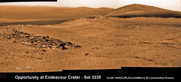"Opportunity rover captures spectacular view ahead to her upcoming mountain climbing goal, the raised rim of ""Solander Point"" at right, located along the western edge of Endeavour Crater. It may harbor clay minerals indicative of a habitable zone.  This pancam photo mosaic was taken on Sol 3335, June 11, 2013.   Credit: NASA/JPL/Cornell/ASU/Marco Di Lorenzo/Ken Kremer (kenkremer.com)   See full panoramic scene below"