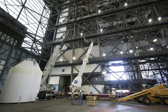 Technicians at work practicing de-stacking operations with full size mockups of the Orion capsule and Launch Abort System components inside the Vehicle Assembly Building at the Kennedy Space Center in Florida. Credit: /Jim Grossmann