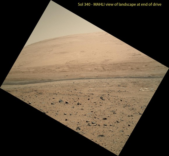 The scene taken on Sol 340 was taken shortly after Curiosity finished her longest yet. The 329.1-foot (100.3-meter) drive was twice as long as any previous sol's drive by Curiosity. The view is toward the south, including a portion of Mount Sharp and a band of dark dunes in front of the mountain.  The Mars Hand Lens Imager (MAHLI) camera on NASA's Curiosity rover is carried at an angle when the rover's arm is stowed for driving. Still, the camera is able to record views of the terrain Curiosity is crossing in Gale Crater, and rotating the image 150 degrees provides this right-side-up scene.  Credit: NASA/JPL-Caltech/MSSS