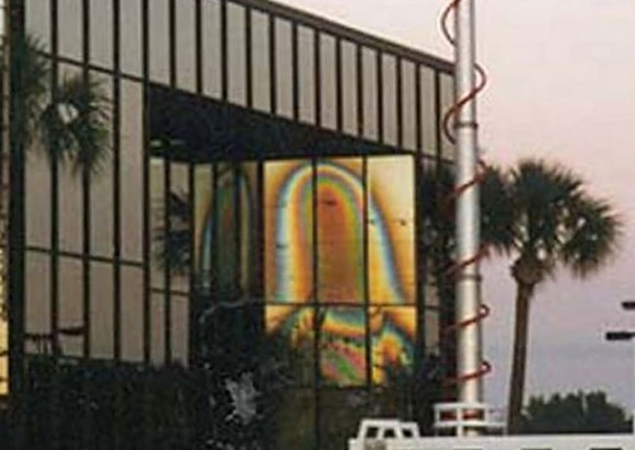 "image of the ""Virgin Mary"" appears in the glass of a Tampa, Florida office building on Christmas Day 1996. Credit: Wikipedia"