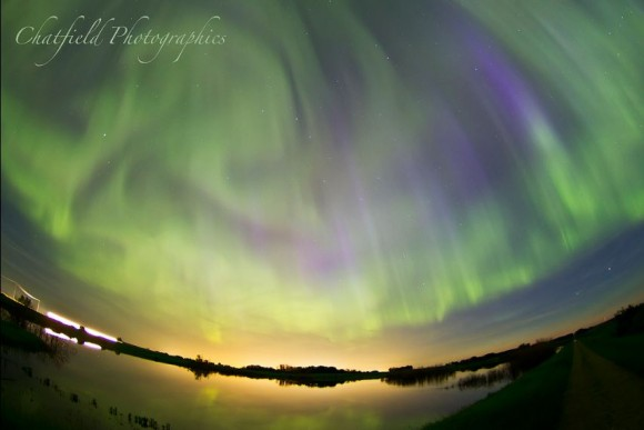 Swirling aurora over Saskatoon, Saskatchewan. Credit and copyright: Colin Chatfield/ Chatfield Photography.