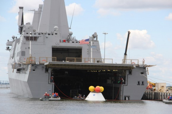 During the stationary recovery test of Orion at Norfolk Naval Base on Aug. 15, US Navy divers attached tow lines and led the test capsule to a flooded well deck on the USS Arlington.  Credit: Ken Kremer/kenkremer.com
