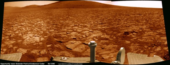 Opportunity rover's 1st mountain climbing goal is dead ahead in this up close view of Solander Point along the eroded rim of Endeavour Crater.  Opportunity will soon ascend the mountain in search of minerals signatures indicative of a past Martian habitable environment.  This navcam panoramic mosaic was assembled from raw images taken on Sol 3385 (Aug 2, 2013).  Credit: NASA/JPL/Cornell/Marco Di Lorenzo/Ken Kremer (kenkremer.com)