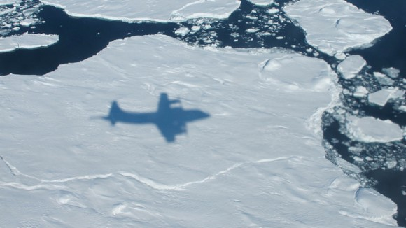 The NASA P-3B's shadow on sea ice off of southeast Greenland during an IceBridge survey on Apr. 9, 2013. Flying at a low altitude allows IceBridge researchers to gather detailed data. Credit: NASA / Jim Yungel