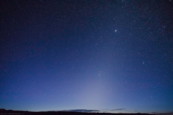 The zodiacal light in the Nevada dawn. The plane of the ecliptic can be traced by Jupiter in Gemini & Mars in the Beehive cluster just below center. (Credit: Cory Schmitz, used with permission).