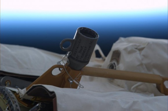 """An adapter recently installed on the ISS's Canadarm 2, with the message, ';Installed by your friendly Expedition 36 Crew."""" Credit: NASA/ESA/Luca Parmitano."""