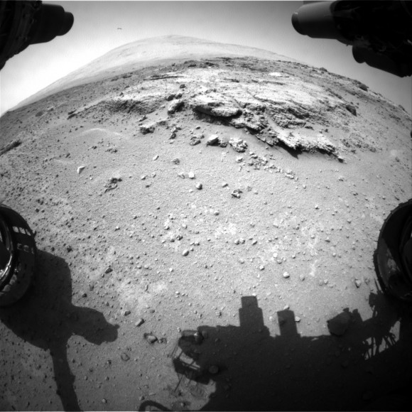 Curiosity's views a rock outcrop after arriving for a short stay at 'Waypoint 1'- dramatically back dropped  by her primary destination, Mount Sharp. Front hazcam camera image from Sol 393 (Sept 13, 2013). Credit: NASA/JPL-Caltech