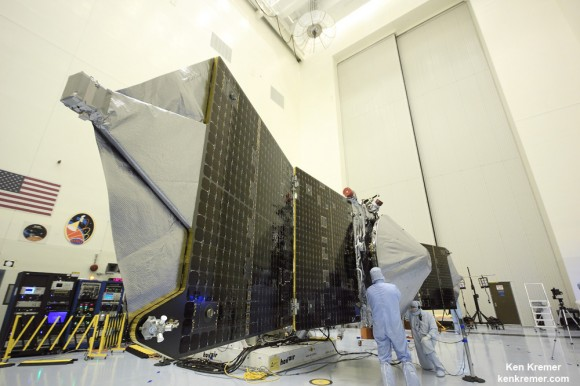 Magnetometer science instrument boom juts out from MAVEN solar panel during launch processing inside the clean room at the Kennedy Space Center.  Credit: Ken Kremer/kenkremer.com