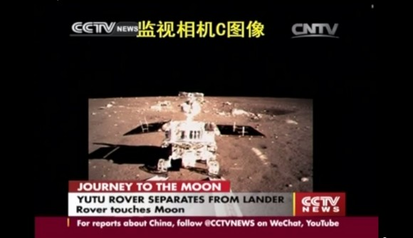 China's first lunar rover separates from Chang'e-3 moon lander early Dec. 15, 2013. Screenshot taken from the screen of the Beijing Aerospace Control Center in Beijing. Credit: CCTV