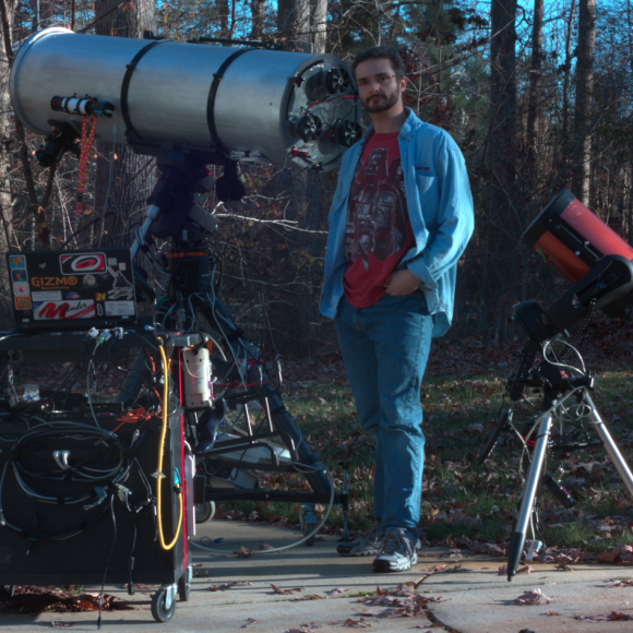 Astrophotographer Michael Phillips with the gear used to capture the Jupiter rotation animation. Credit-Michael Phillips