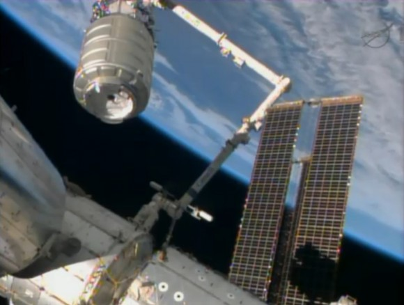 ISS Astronauts grapple Orbital Sciences Cygnus spacecraft with robotic arm and guide it to docking port. Credit: NASA TV