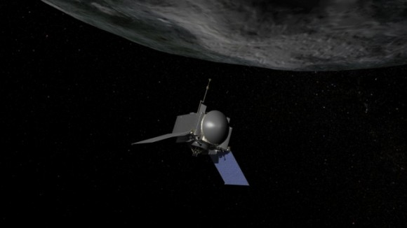 This is an artist's concept of NASA's OSIRIS-REx spacecraft preparing to take a sample from asteroid Bennu. Credit:  NASA/Goddard/Chris Meaney