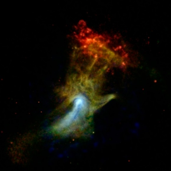 "The ""Hand ( or Fist?) of God"" nebula enshrouding pulsar PSR B1509-58. The upper red cloud structure is RCW 89. The image is a composite of Chandra observations (red & green), while NuSTAR observations are denoted in blue."