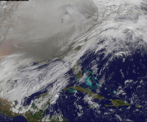This image was captured by NOAA's GOES-East satellite on January 6, 2014 at 1601 UTC/11:01 a.m. EST. A frontal system that brought rain to the coast is draped from north to south along the U.S. East Coast. Behind the front lies the clearer skies bitter cold air associ