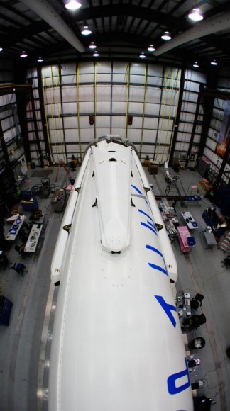 All four landing legs now mounted on Falcon 9 rocket being processed inside hanger at Cap