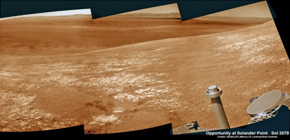 NASA's Opportunity rover was imaged here from Mars orbit by MRO HiRISE camera on Feb. 14, 2014.  This mosaic shows Opportunity's view today while looking back to vast Endeavour crater from atop Murray Ridge by summit of Solander Point.  Opportunity captured this photomosaic view on Feb. 16, 2014 (Sol 3579) from the western rim of Endeavour Crater where she is investigating outcrops of potential clay minerals formed in liquid water.  Assembled from Sol 3579 colorized navcam raw images.  Credit: NASA/JPL/Cornell/Marco Di Lorenzo/Ken Kremer-kenkremer.com