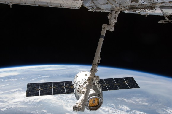 The robotic Canadarm2 is routinely used to berth spacecraft to the International Space Station, such as SpaceX's Dragon. Credit: NASA