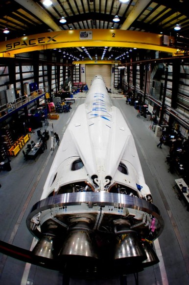 The Falcon 9 rocket with landing legs in SpaceX's hangar at Cape Canaveral, Fl, preparing to launch Dragon to the space station this Sunday March 30. Credit: SpaceX
